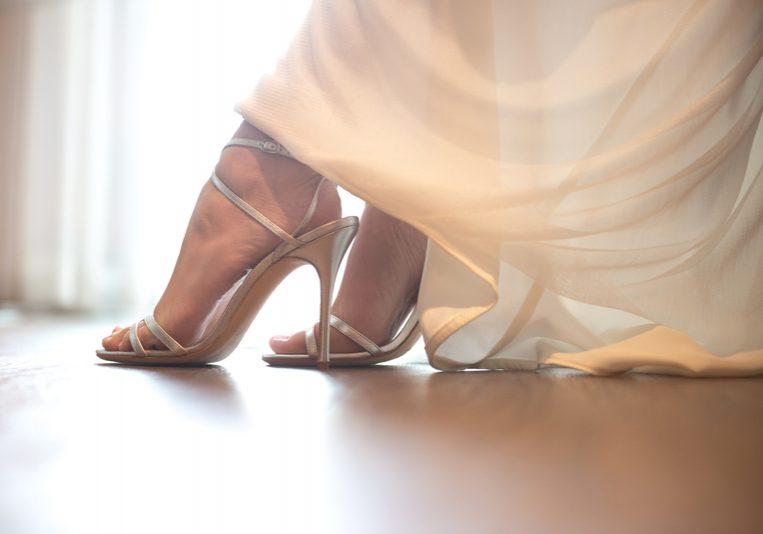 Bride wearing wedding shoes